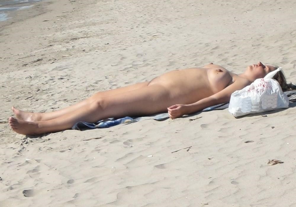Nude blonde at beach-5010