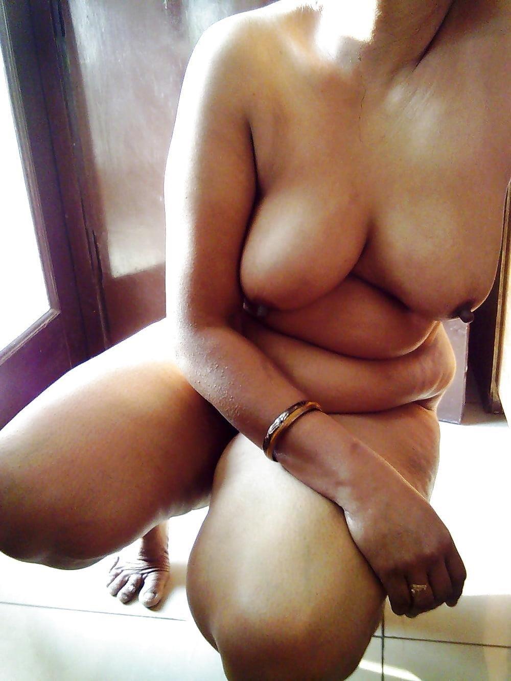 Nude beach sun bath-7491
