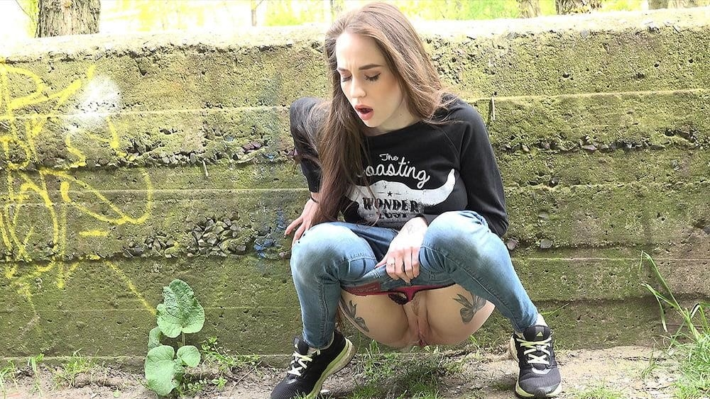 Teen girl peeing in public-7020
