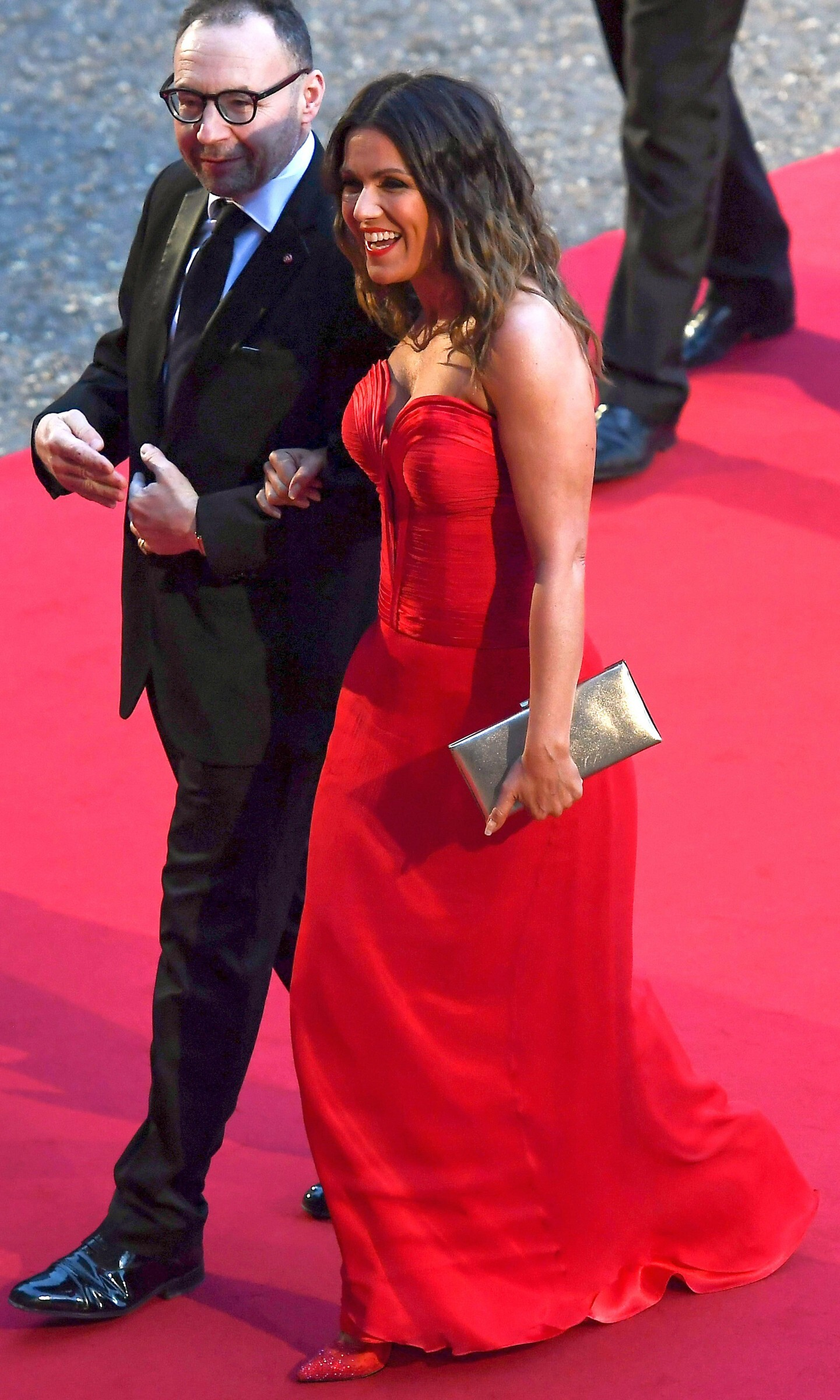 Susanna Reid's deep cleavage at GQ Men of the Year Awards & afterparty at Tate Modern in London wearing a red dress, 09/03/2019.