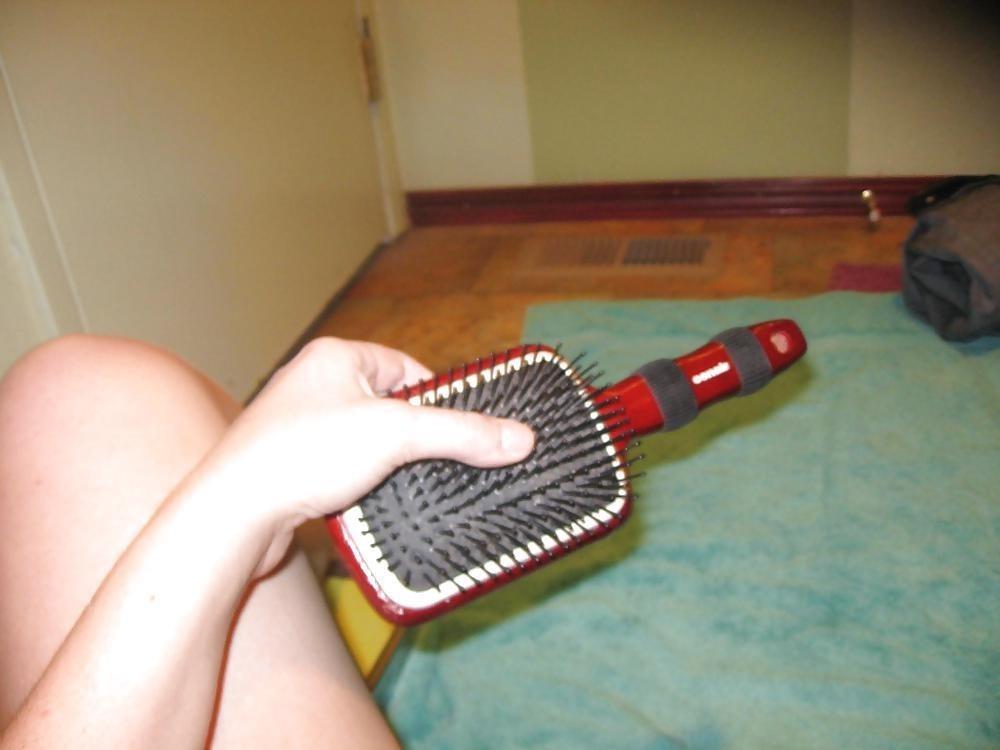Girl masterbating with hairbrush-9423