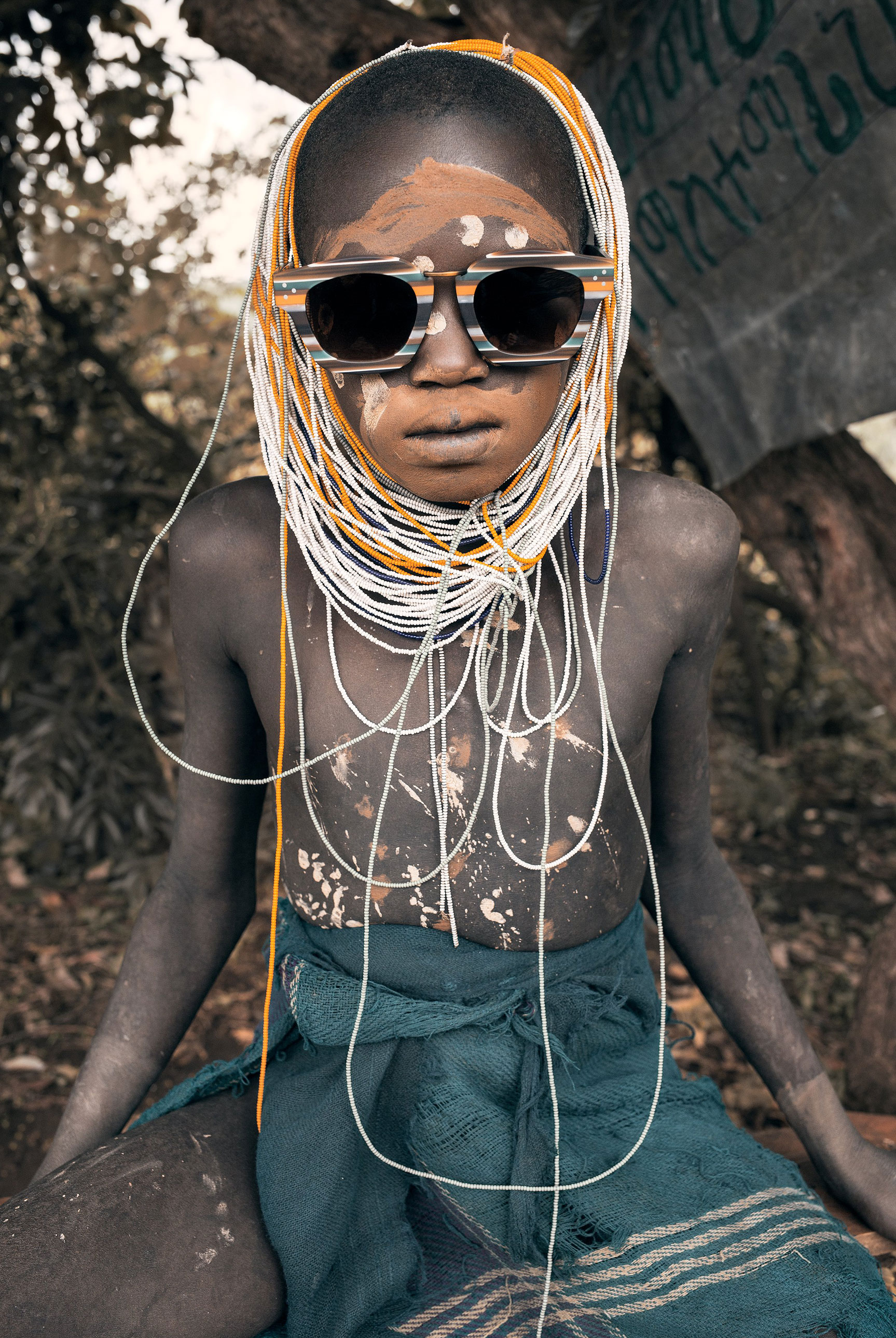 the Surma tribe and Marisa Papen nude by Jesse Walker - Enki EyeWear - Ethiopia 2017